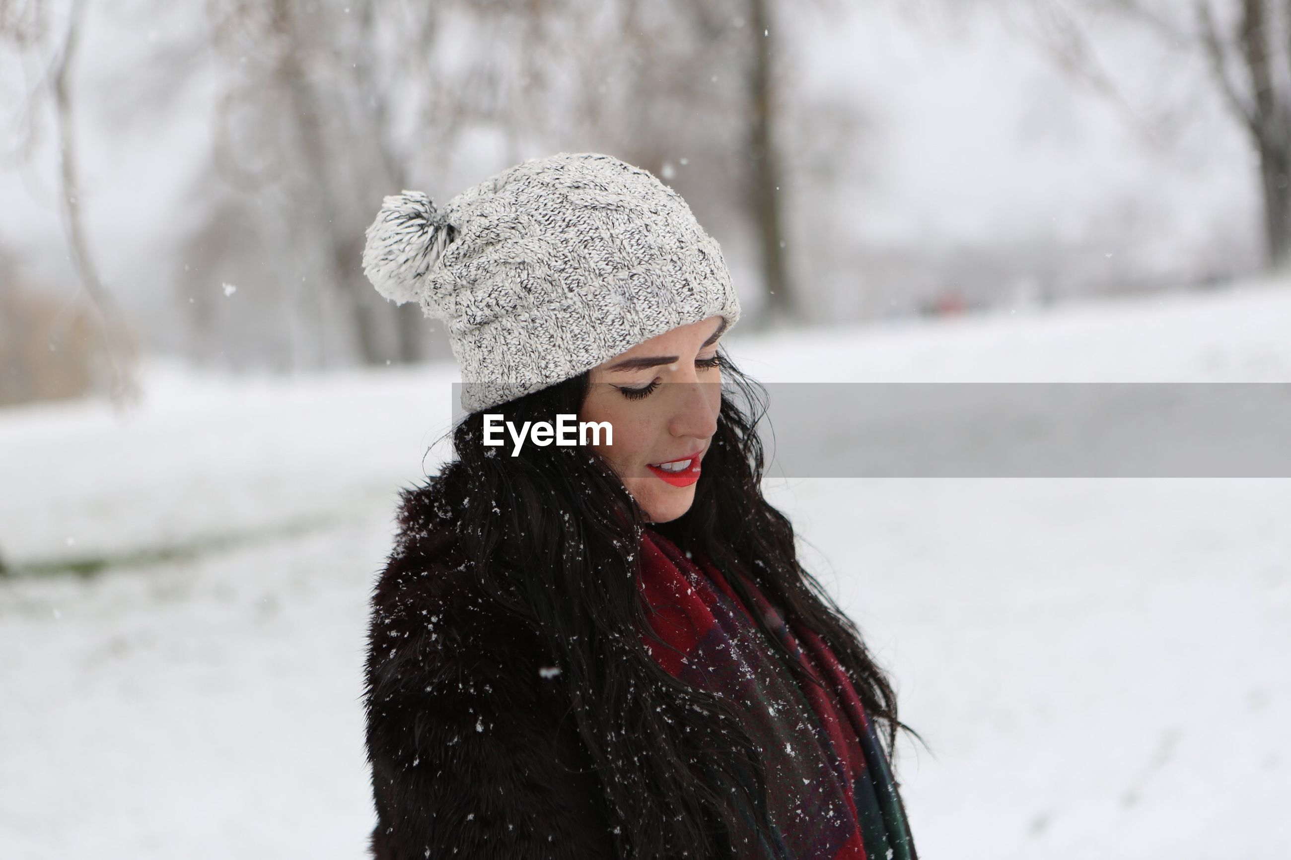 winter, snow, cold temperature, warm clothing, one person, weather, leisure activity, real people, outdoors, lifestyles, focus on foreground, nature, day, beautiful woman, young women, scarf, snowing, young adult, smiling, beauty in nature, close-up, people