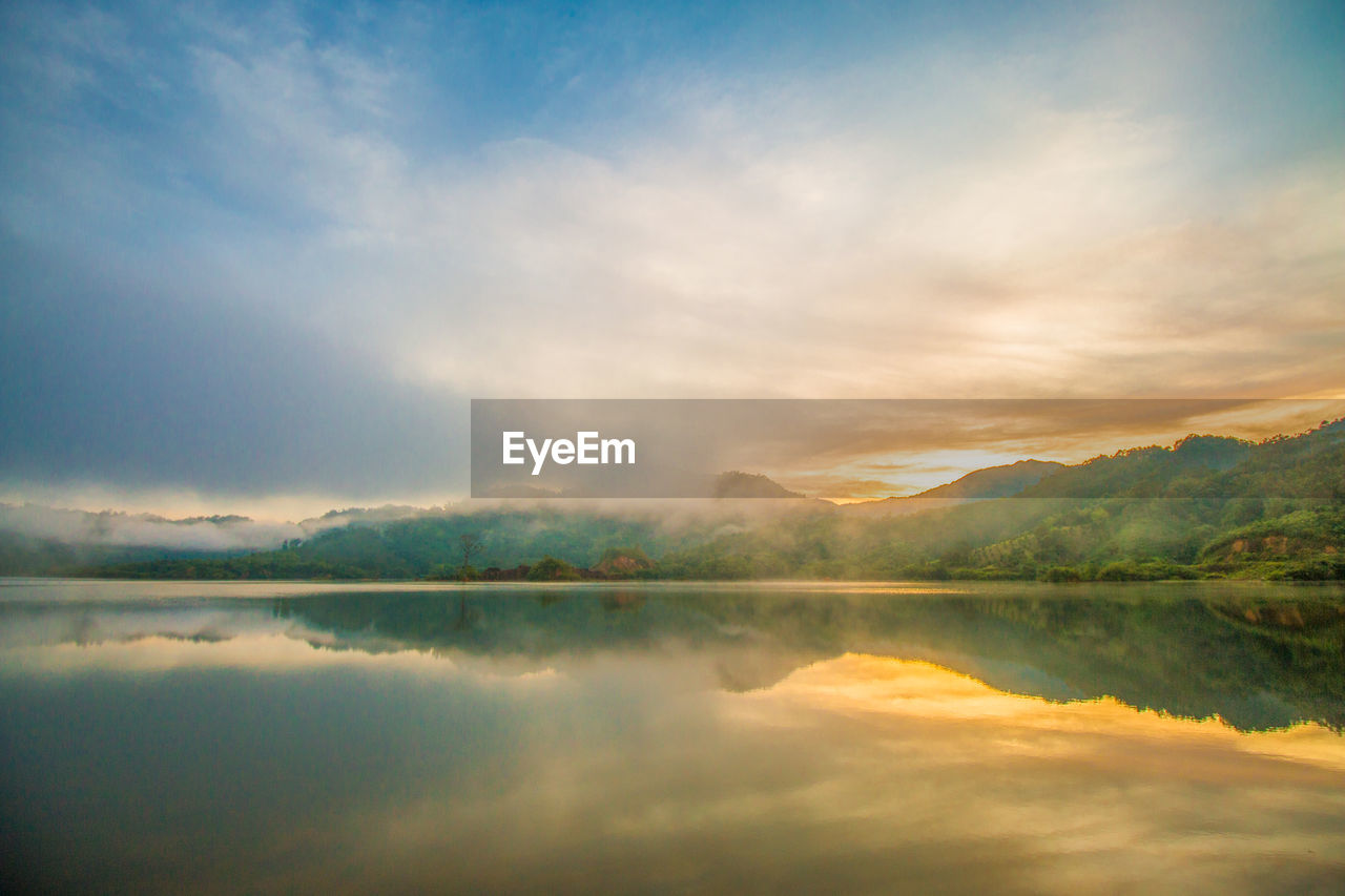 tranquility, tranquil scene, water, beauty in nature, lake, sky, scenics - nature, cloud - sky, reflection, waterfront, idyllic, nature, no people, non-urban scene, symmetry, sunset, mountain, outdoors, orange color, reflection lake
