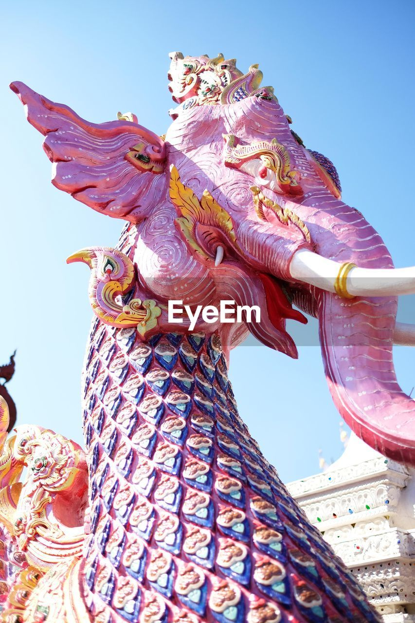statue, art and craft, sculpture, low angle view, spirituality, religion, no people, day, outdoors, sunlight, clear sky, sky, multi colored, architecture, dragon, chinese dragon, close-up