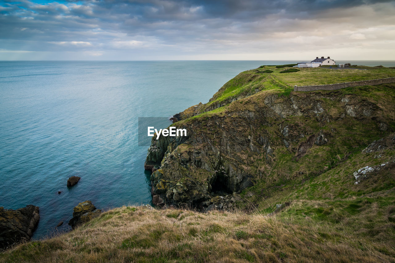 sea, water, sky, scenics - nature, horizon over water, rock, tranquility, tranquil scene, beauty in nature, rock - object, cloud - sky, horizon, land, nature, solid, no people, beach, plant, grass