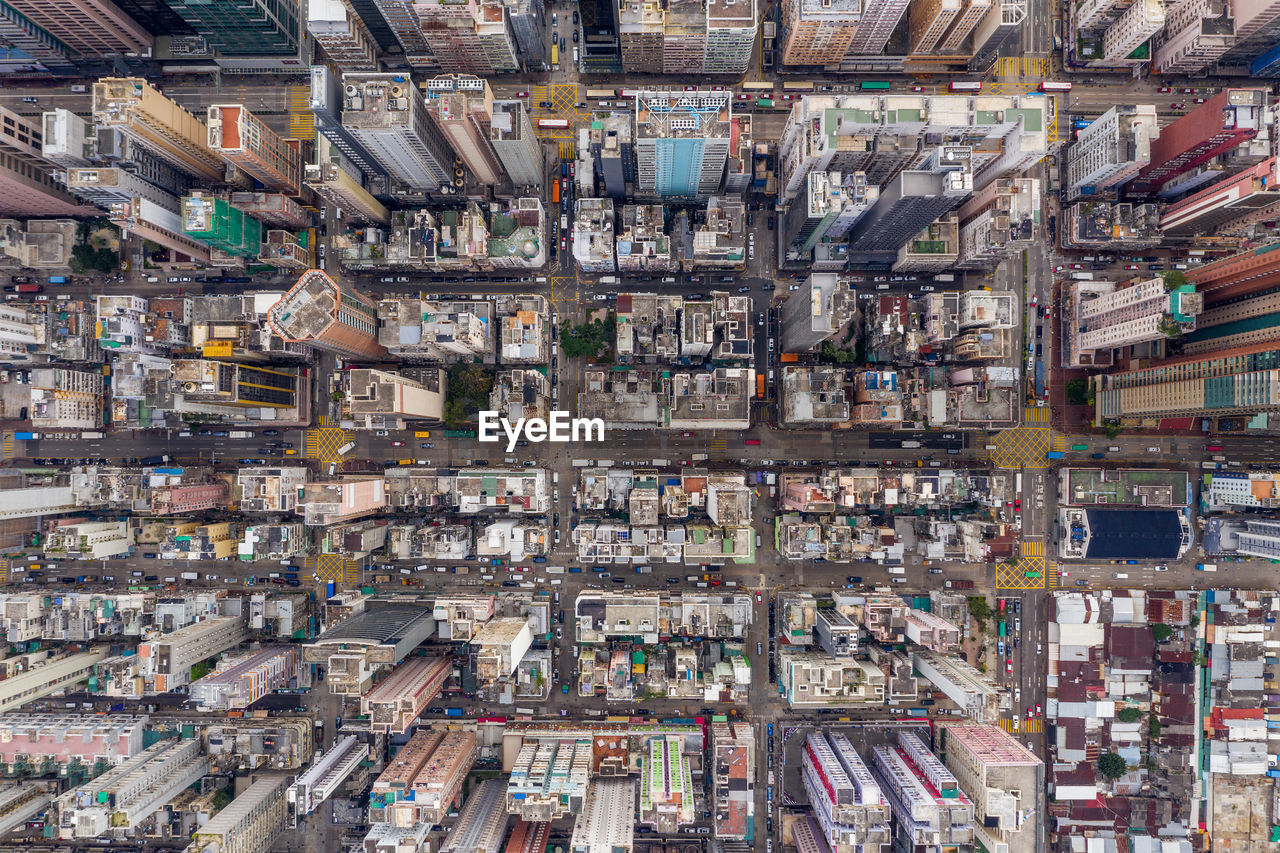 backgrounds, full frame, architecture, large group of objects, abundance, no people, city, aerial view, day, high angle view, building, building exterior, built structure, pattern, travel destinations, cityscape, digital composite, skyscraper, chaos, excess