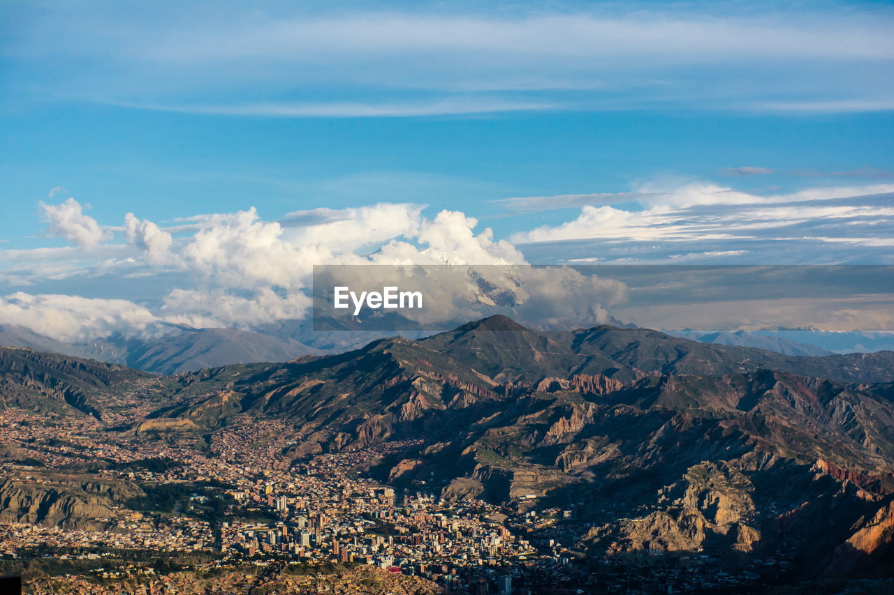 Aerial View Of Clouds Over Mountain Range