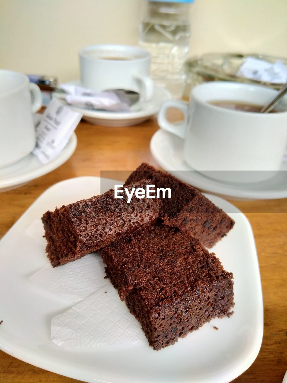 CLOSE-UP OF CAKE WITH COFFEE
