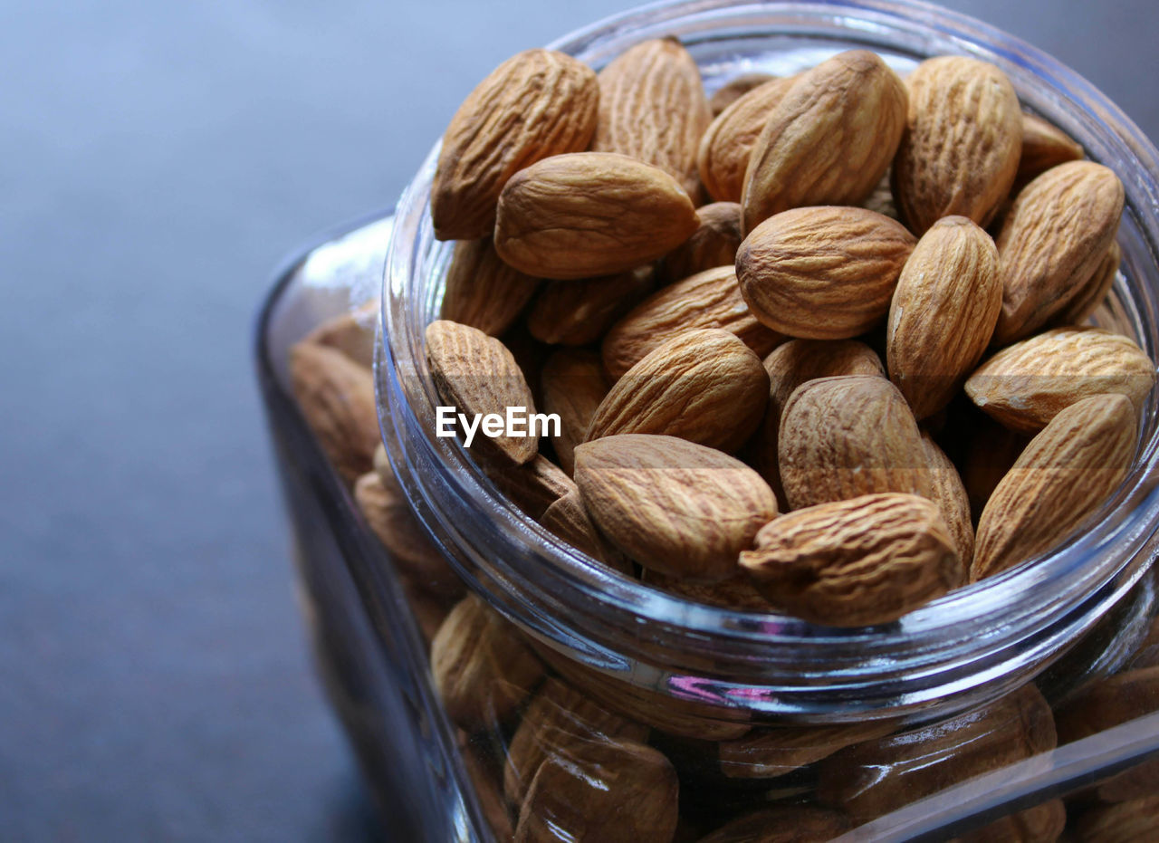 Close-up of almonds in jar on table