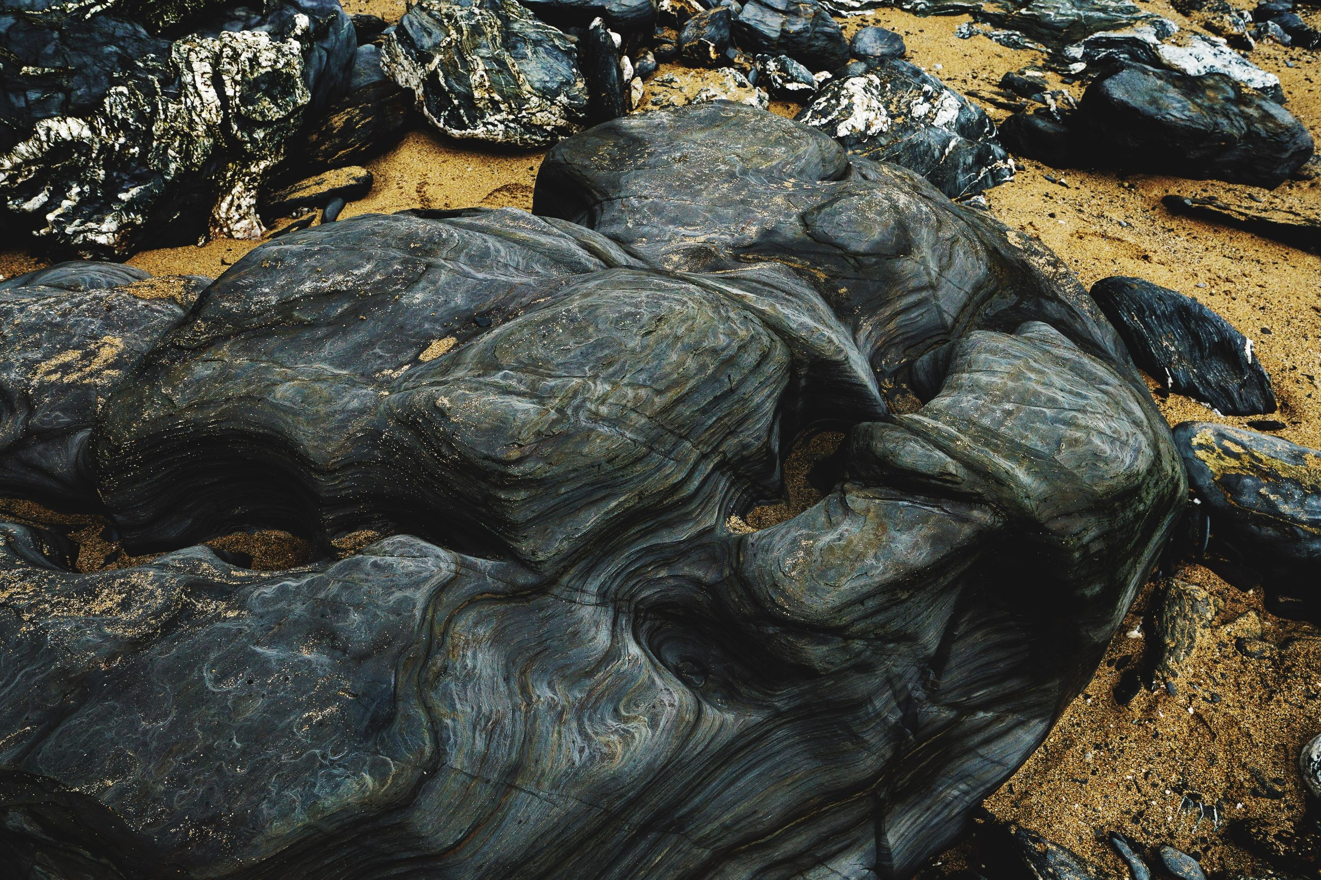 High angle view of rock formations at beach