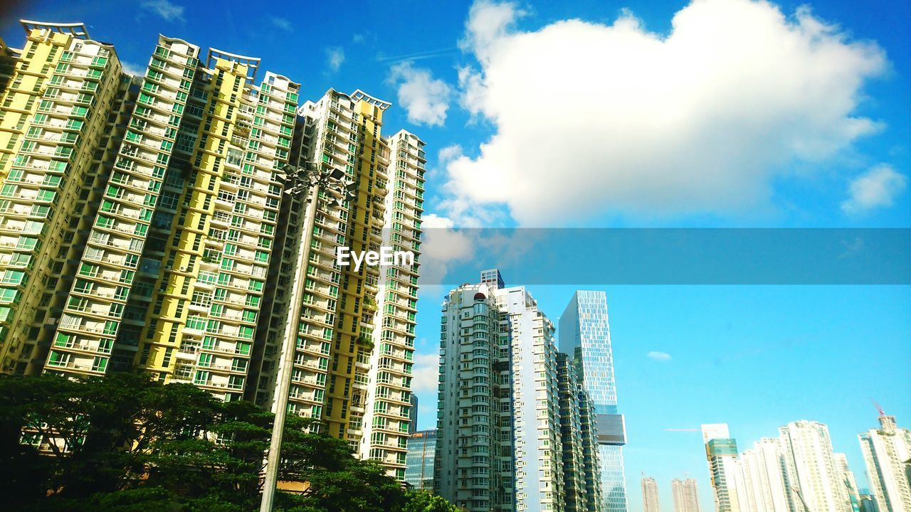 architecture, building exterior, skyscraper, built structure, city, tall - high, sky, modern, cityscape, low angle view, development, outdoors, day, cloud - sky, blue, urban skyline, no people, growth, tall, apartment