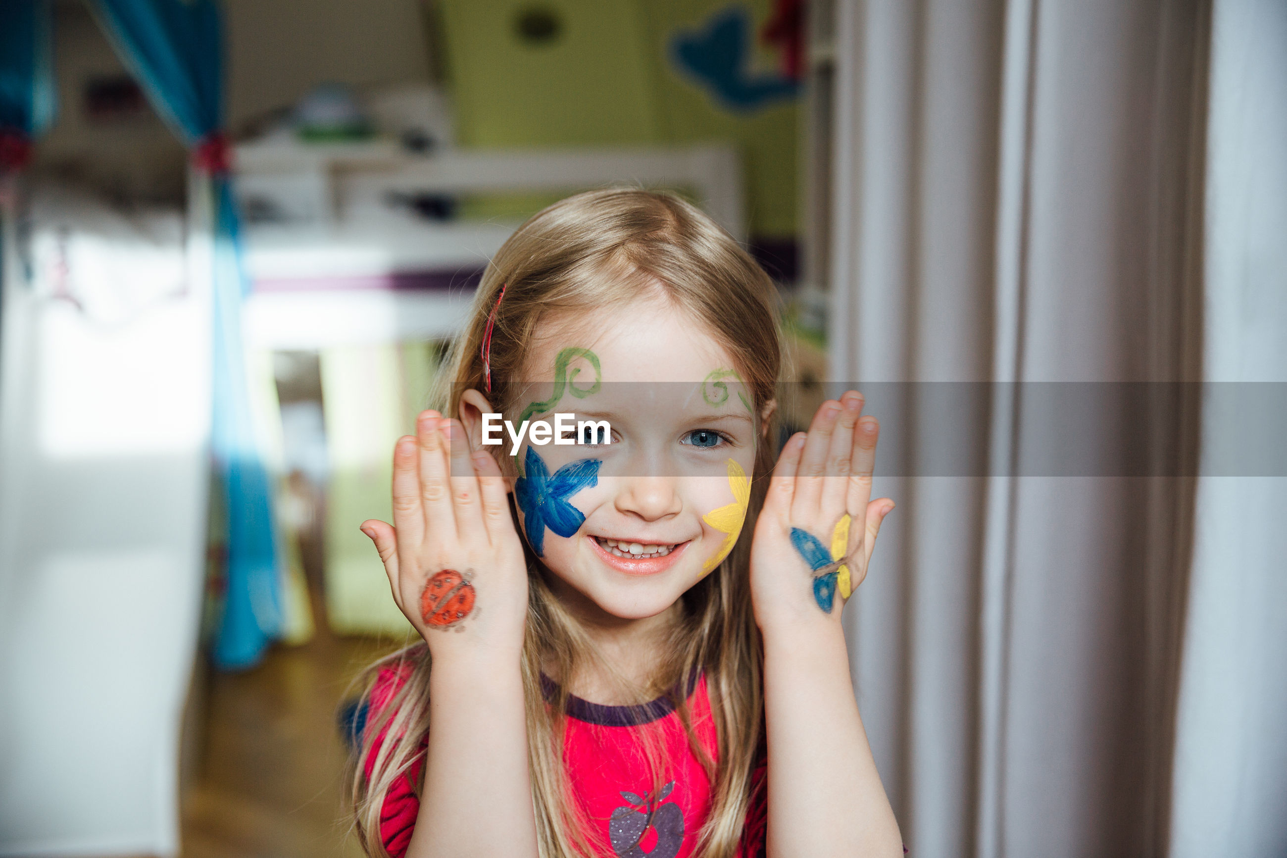 Portrait of cute girl with face paint