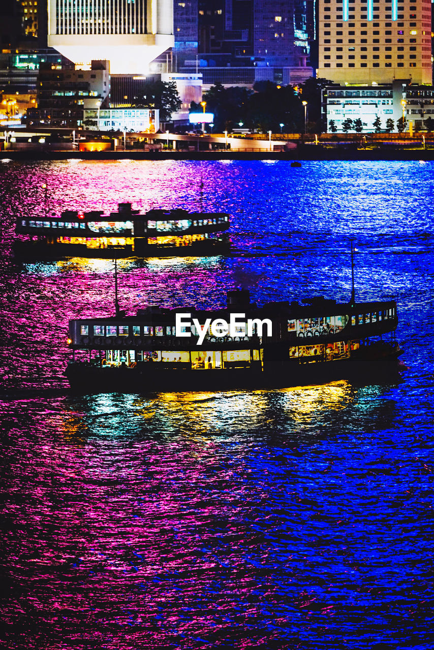 architecture, water, building exterior, city, built structure, illuminated, waterfront, nautical vessel, transportation, river, no people, nature, night, reflection, mode of transportation, outdoors, building, cityscape, ferry, passenger craft