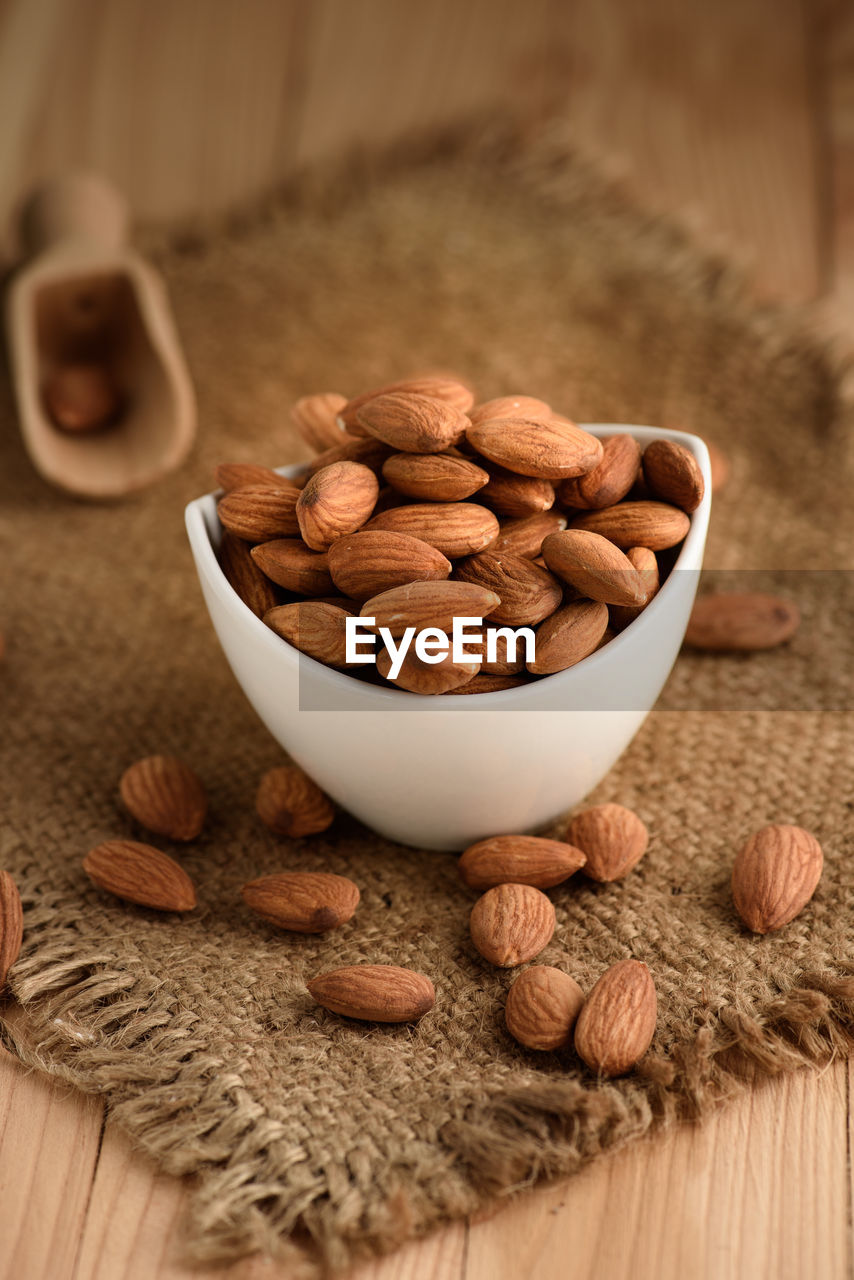 food and drink, food, bowl, indoors, freshness, wellbeing, large group of objects, brown, close-up, still life, healthy eating, no people, table, abundance, nut, wood - material, high angle view, selective focus, focus on foreground, nut - food, snack