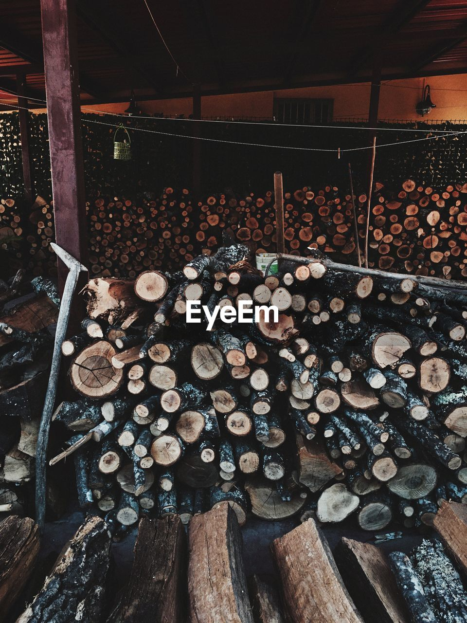 timber, wood, log, wood - material, lumber industry, deforestation, abundance, large group of objects, tree, firewood, forest, stack, no people, indoors, day, arrangement, warehouse, environmental issues, woodpile