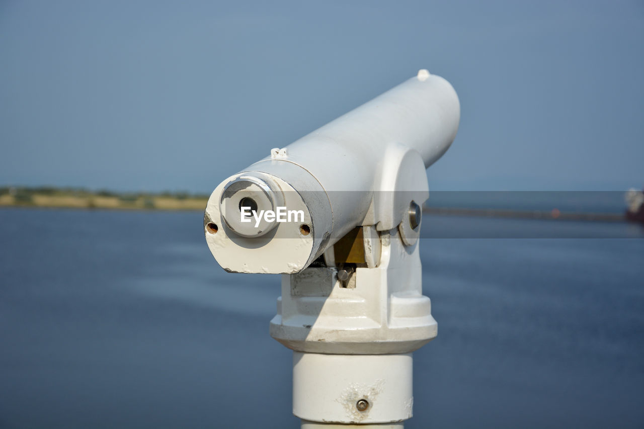water, sea, coin operated, nature, surveillance, no people, sky, binoculars, day, white color, focus on foreground, close-up, technology, coin-operated binoculars, metal, blue, security, outdoors, sunlight, astronomy, hand-held telescope