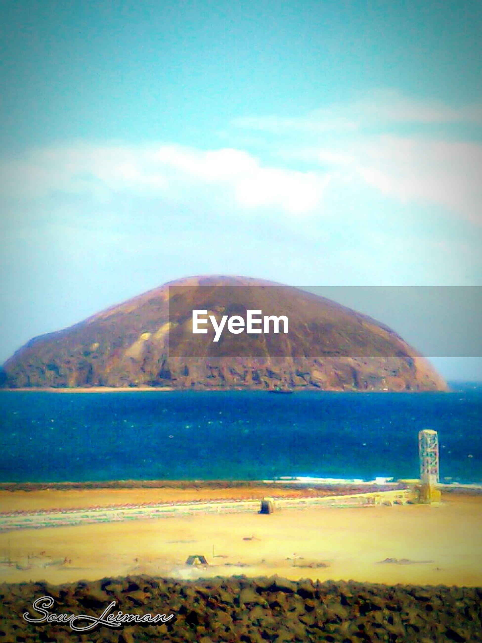 sea, water, beach, sky, mountain, scenics, tranquil scene, tranquility, sand, beauty in nature, shore, blue, nature, cloud - sky, coastline, idyllic, mountain range, cloud, horizon over water, day