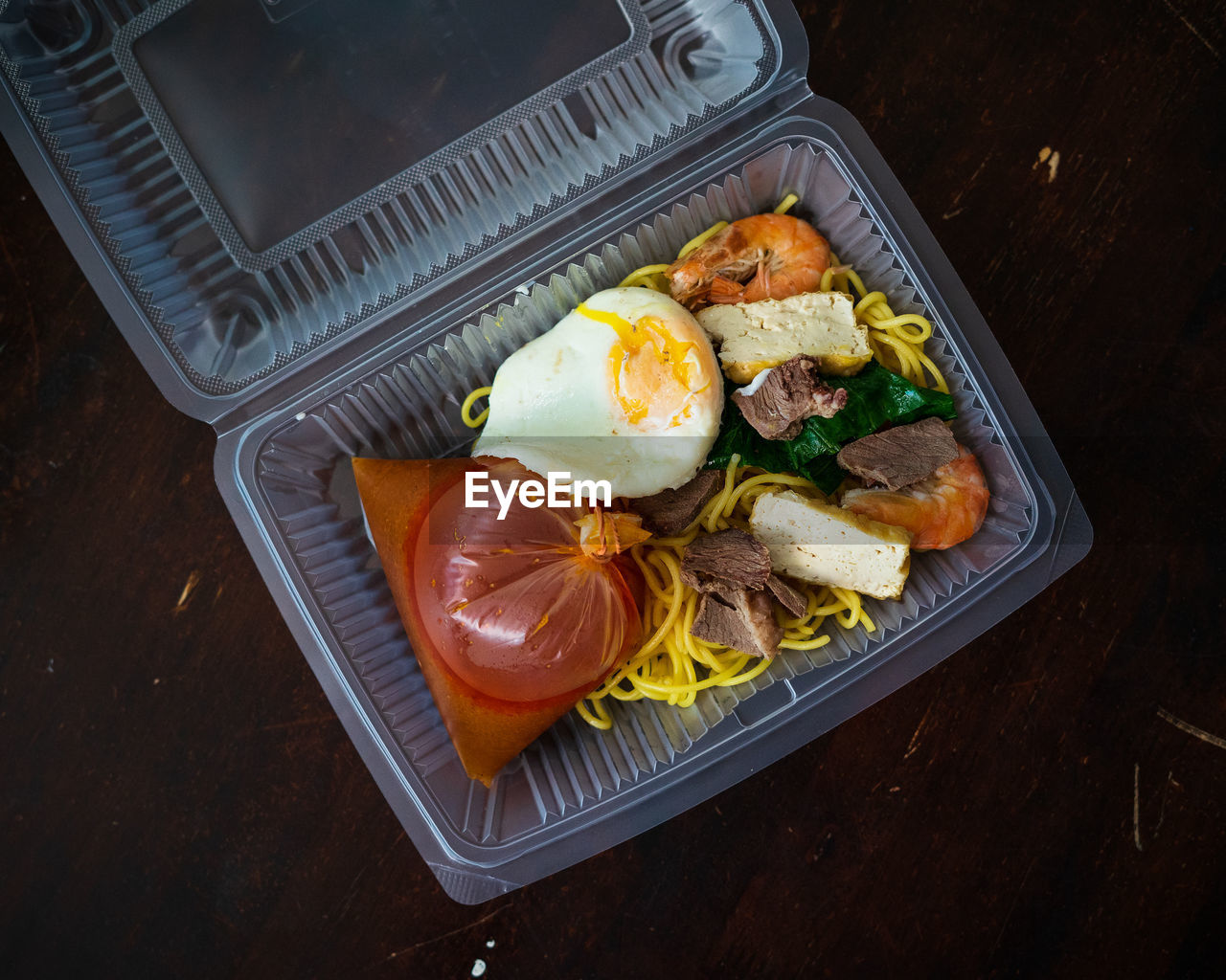 Mee bandung muar in a take out box, a malaysia delicacy noodle originated from muar, malaysia.