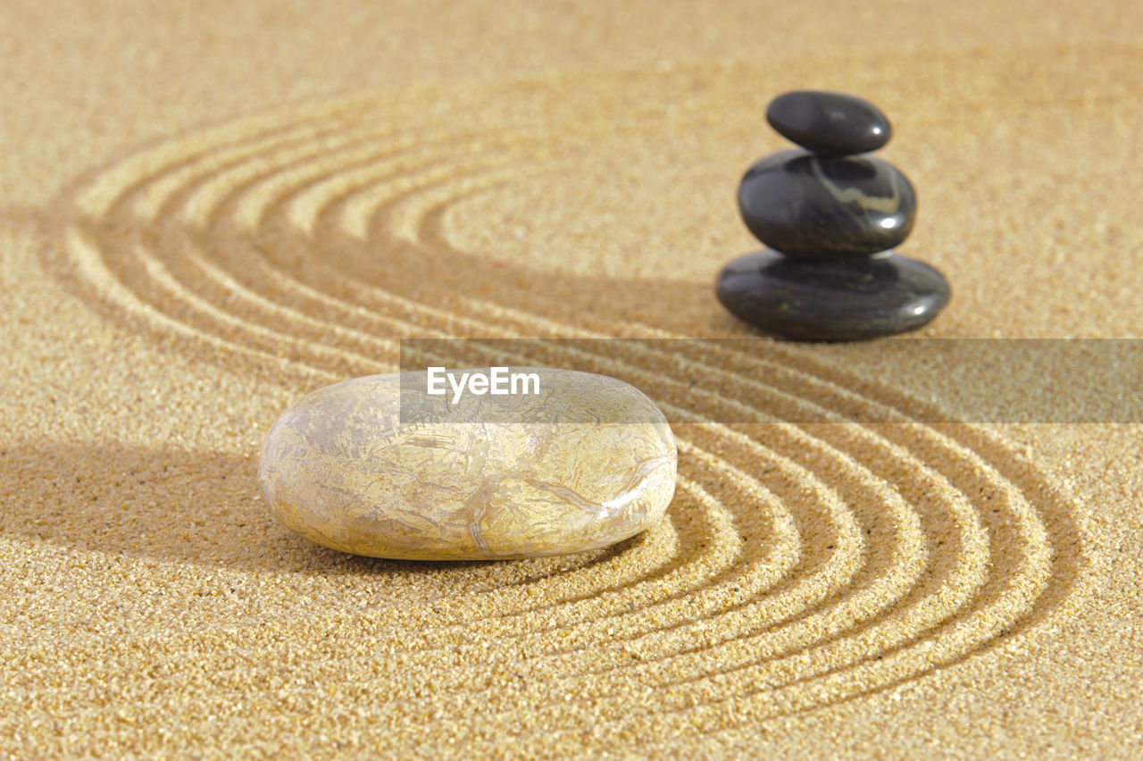 pebble, sand, stone, land, zen-like, rock, stone - object, solid, no people, still life, beach, close-up, balance, nature, rock - object, focus on foreground, pattern, shape, circle, indoors