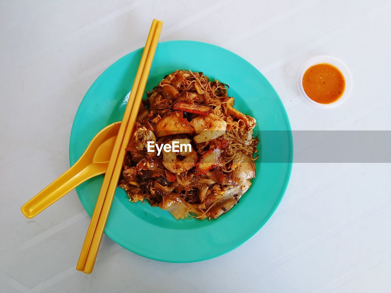 food, food and drink, freshness, ready-to-eat, pasta, table, still life, italian food, wellbeing, healthy eating, meat, serving size, plate, indoors, chopsticks, high angle view, no people, meal, bowl, kitchen utensil, dinner, chinese food, temptation