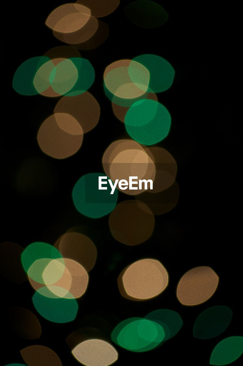 illuminated, night, circle, defocused, lighting equipment, no people, green color, multi colored, christmas, black background, close-up, outdoors, projection equipment