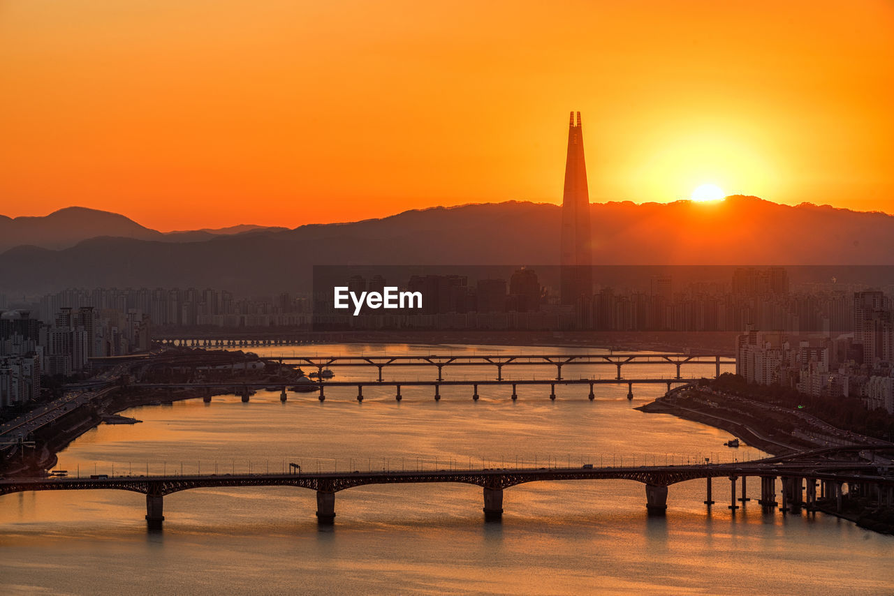 Scenic View Of Cityscape Against Sky During Sunset