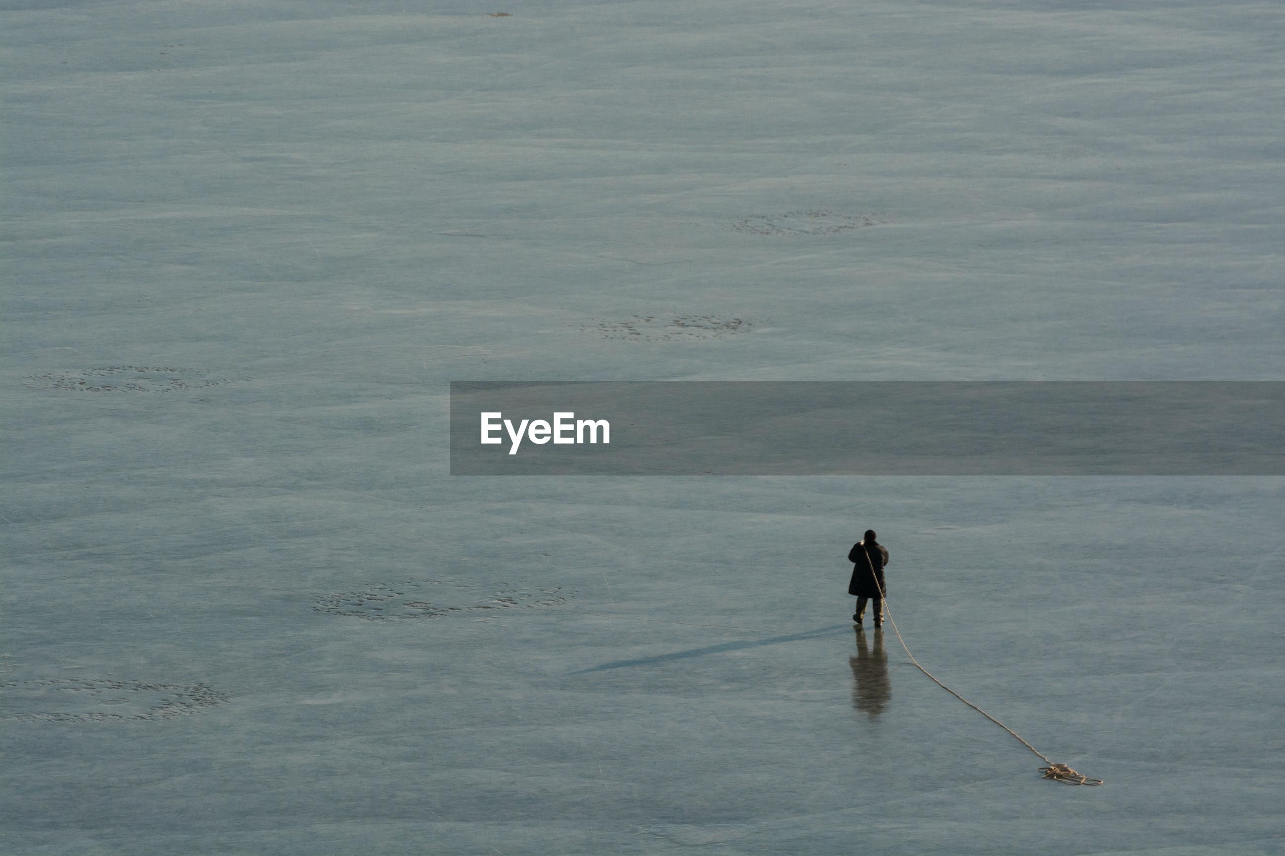 Full length of man fishing