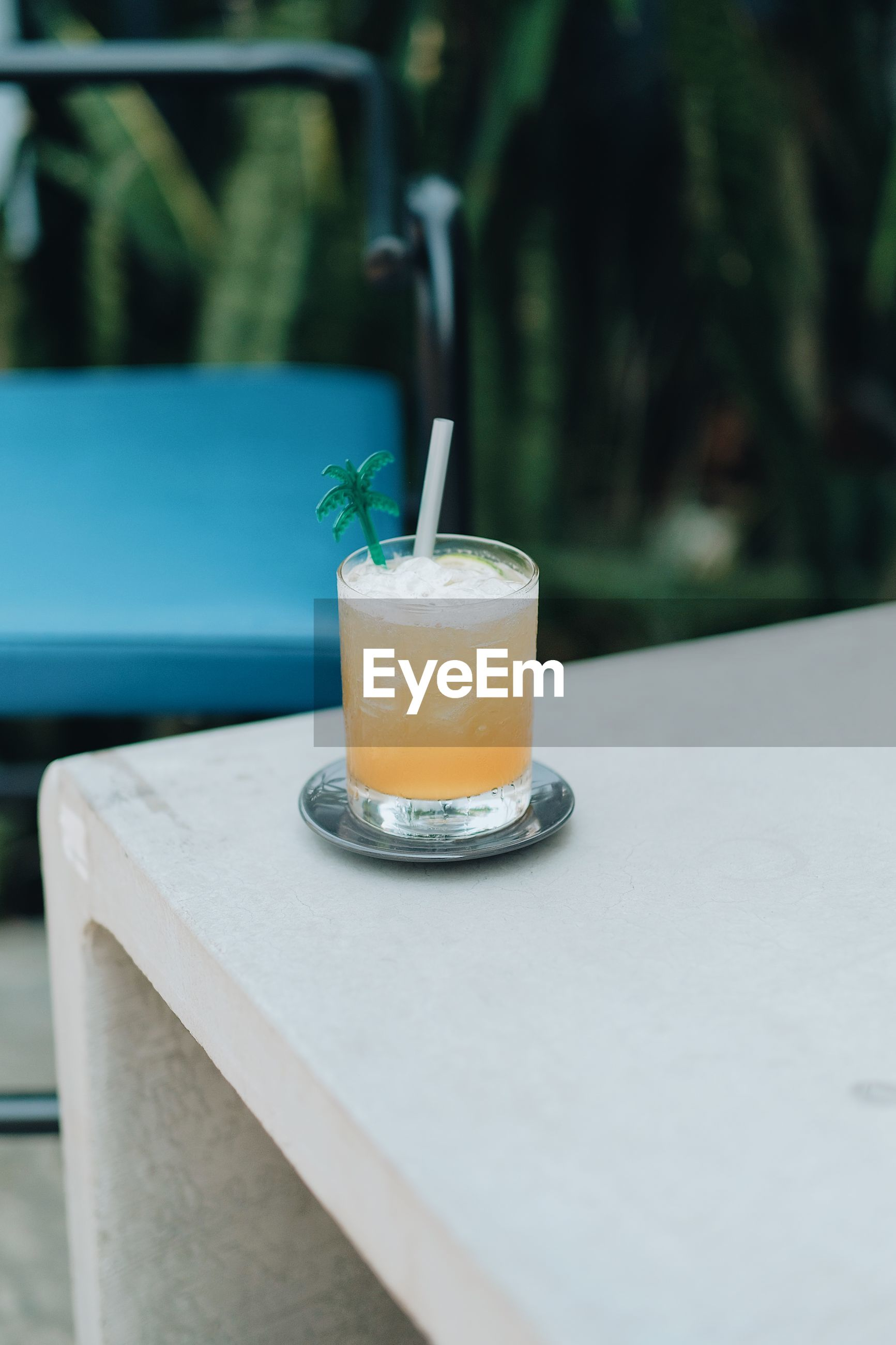 Close-up of tropical drink on table outdoors