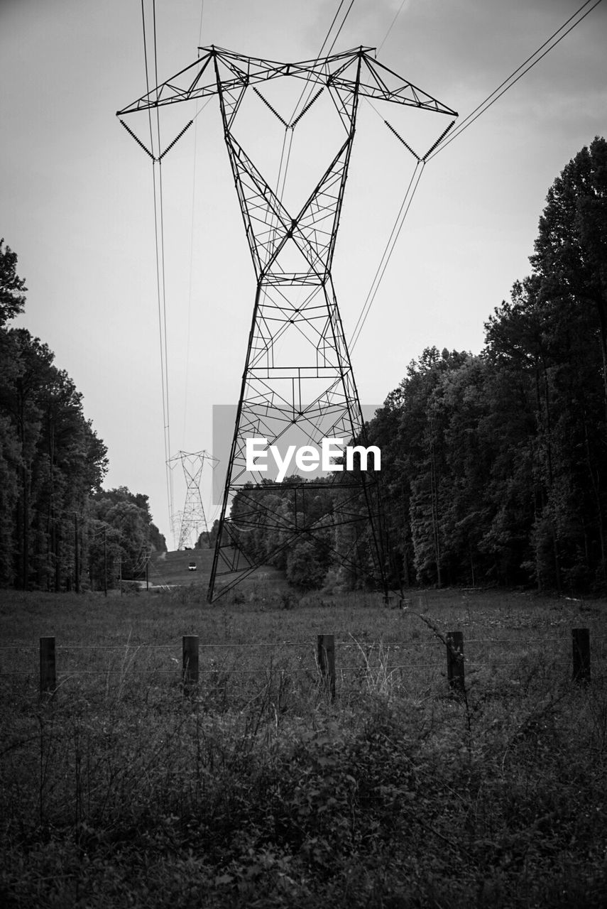 tree, plant, sky, electricity, land, field, cable, power line, electricity pylon, nature, technology, power supply, connection, no people, fuel and power generation, day, landscape, environment, outdoors, clear sky, global communications