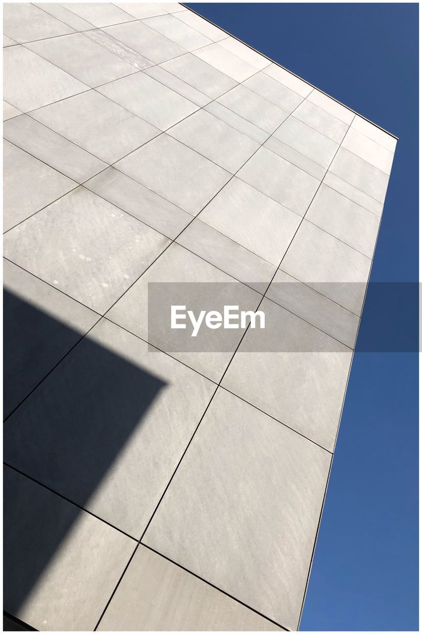 day, architecture, nature, no people, sky, built structure, sunlight, building exterior, shadow, outdoors, pattern, low angle view, geometric shape, shape, building, flooring, tile, clear sky, close-up, city, tiled floor
