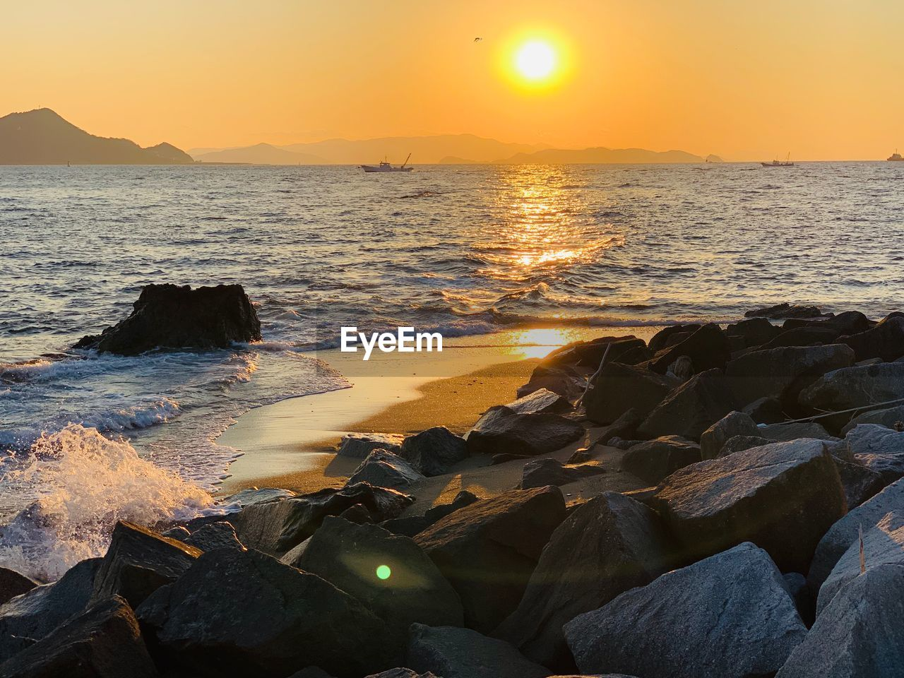 sea, water, sunset, rock, beauty in nature, scenics - nature, sky, beach, solid, rock - object, land, sun, tranquility, nature, idyllic, orange color, tranquil scene, horizon, horizon over water, no people, outdoors, rocky coastline