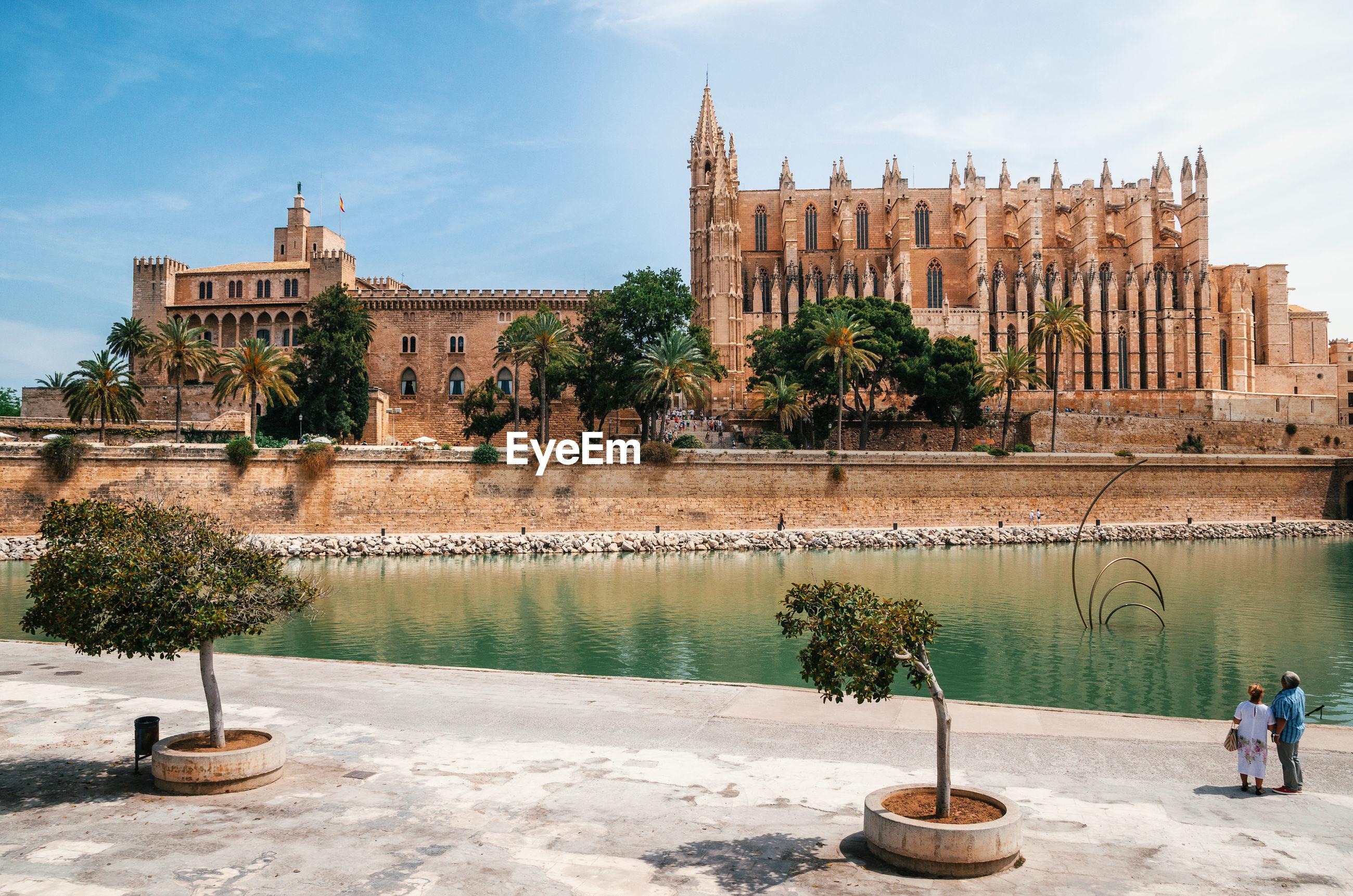 Palma cathedral and royal palace of la almudaina by river