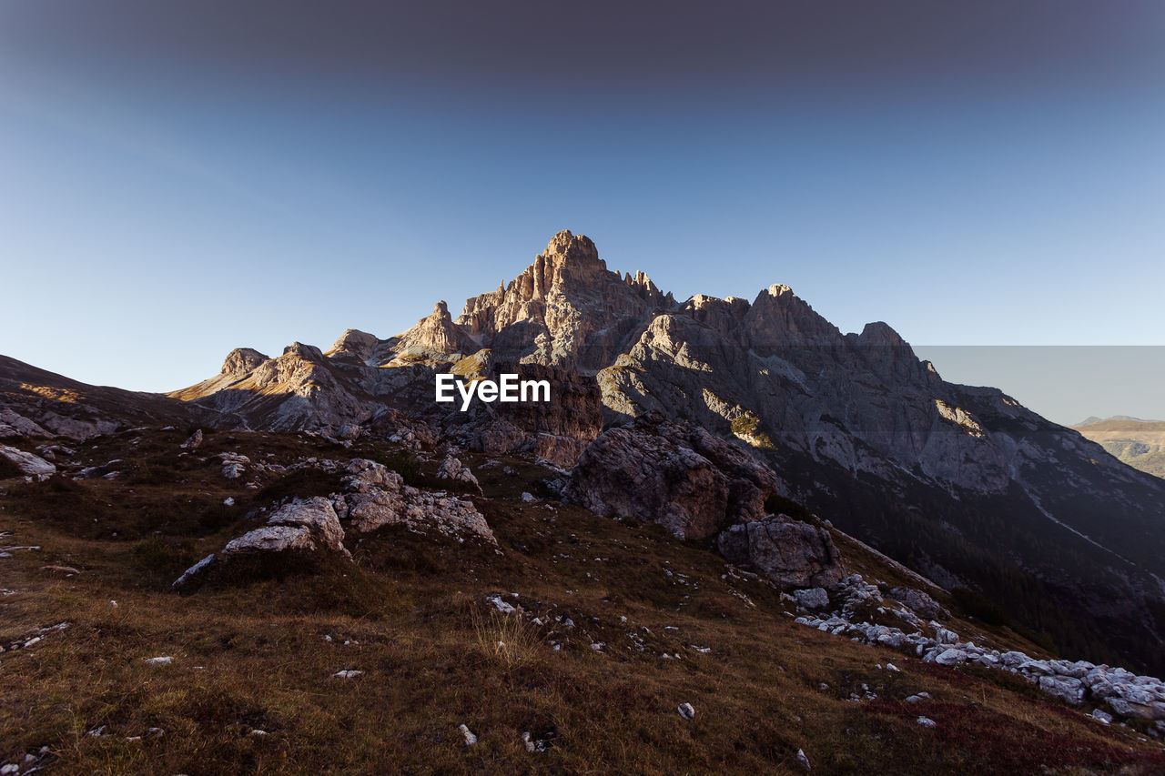 sky, mountain, clear sky, landscape, beauty in nature, tranquil scene, tranquility, environment, nature, rock, scenics - nature, no people, mountain range, non-urban scene, mountain peak, copy space, idyllic, day, land, blue, outdoors, formation, high, arid climate