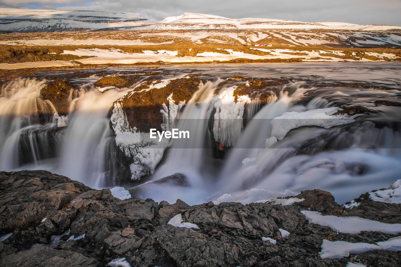 Scenic view of waterfall during winter