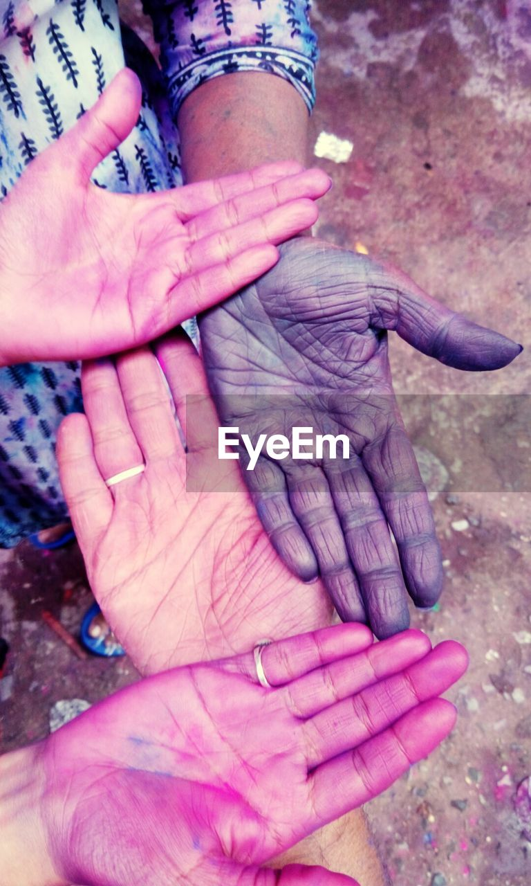 human hand, human body part, real people, human finger, holding, close-up, outdoors, day, palm, women, lifestyles, adult, people