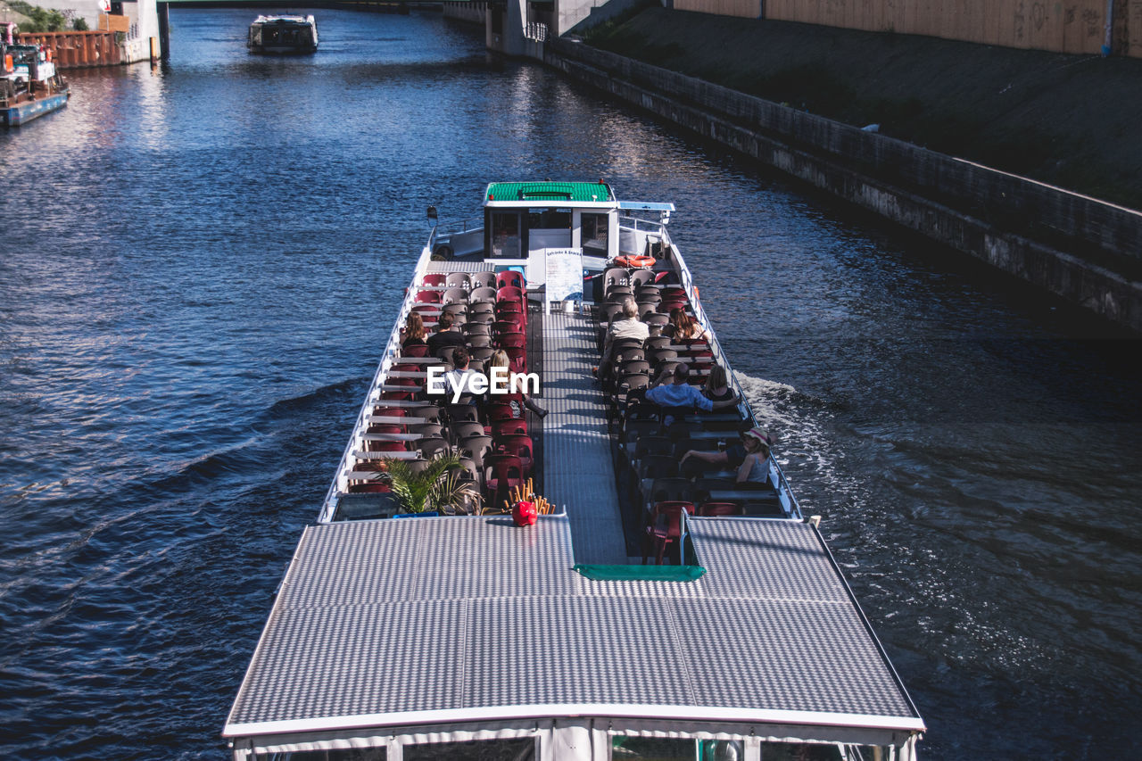 High Angle View Of People In Ferryboat At Lake