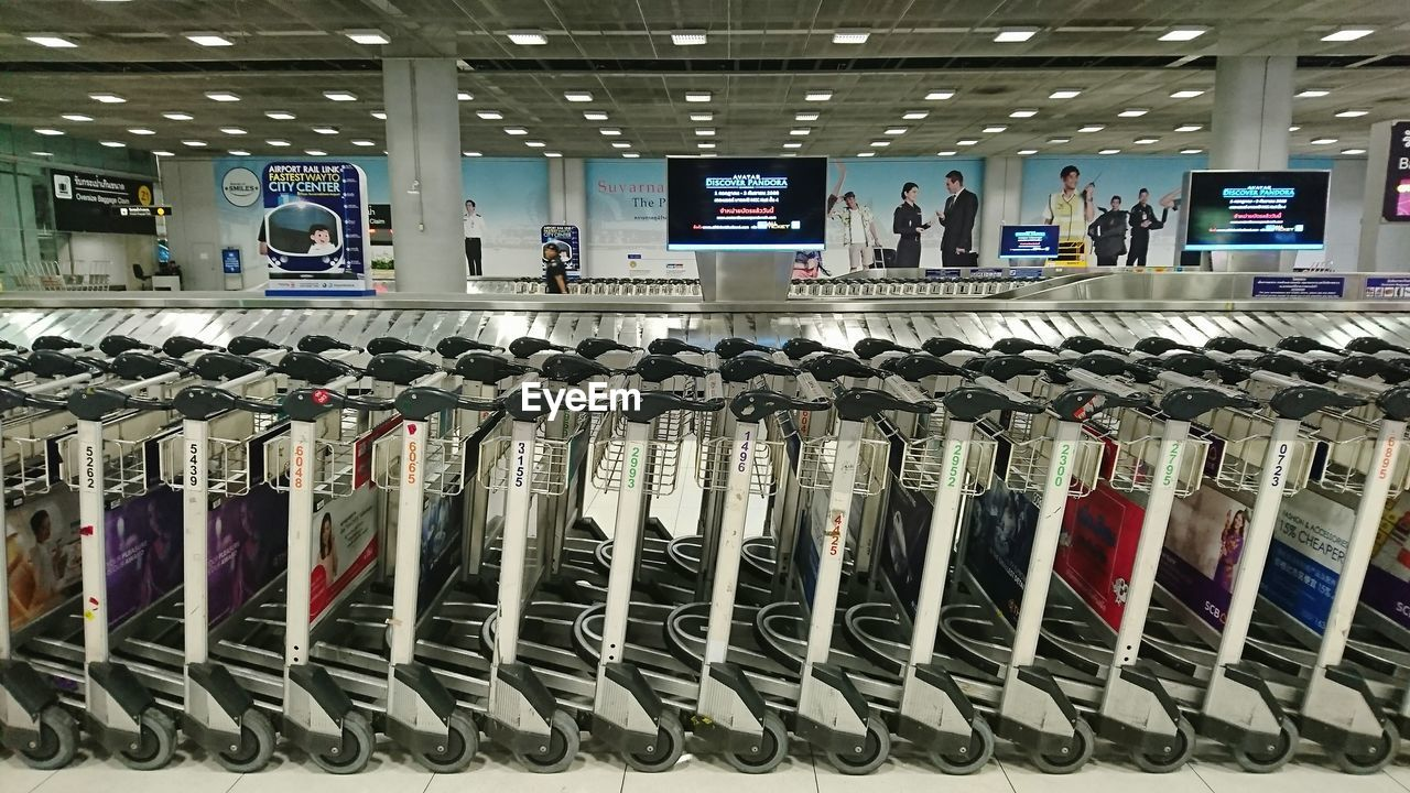 indoors, large group of objects, airport, luggage, day, no people
