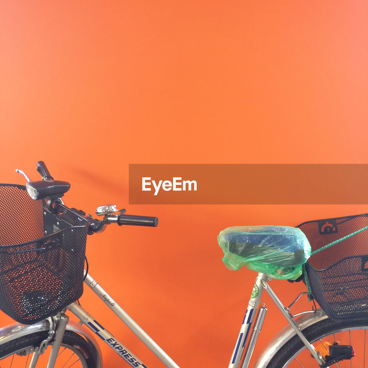 bicycle, mode of transport, transportation, land vehicle, stationary, orange color, bicycle basket, no people, outdoors, day, scooter, close-up
