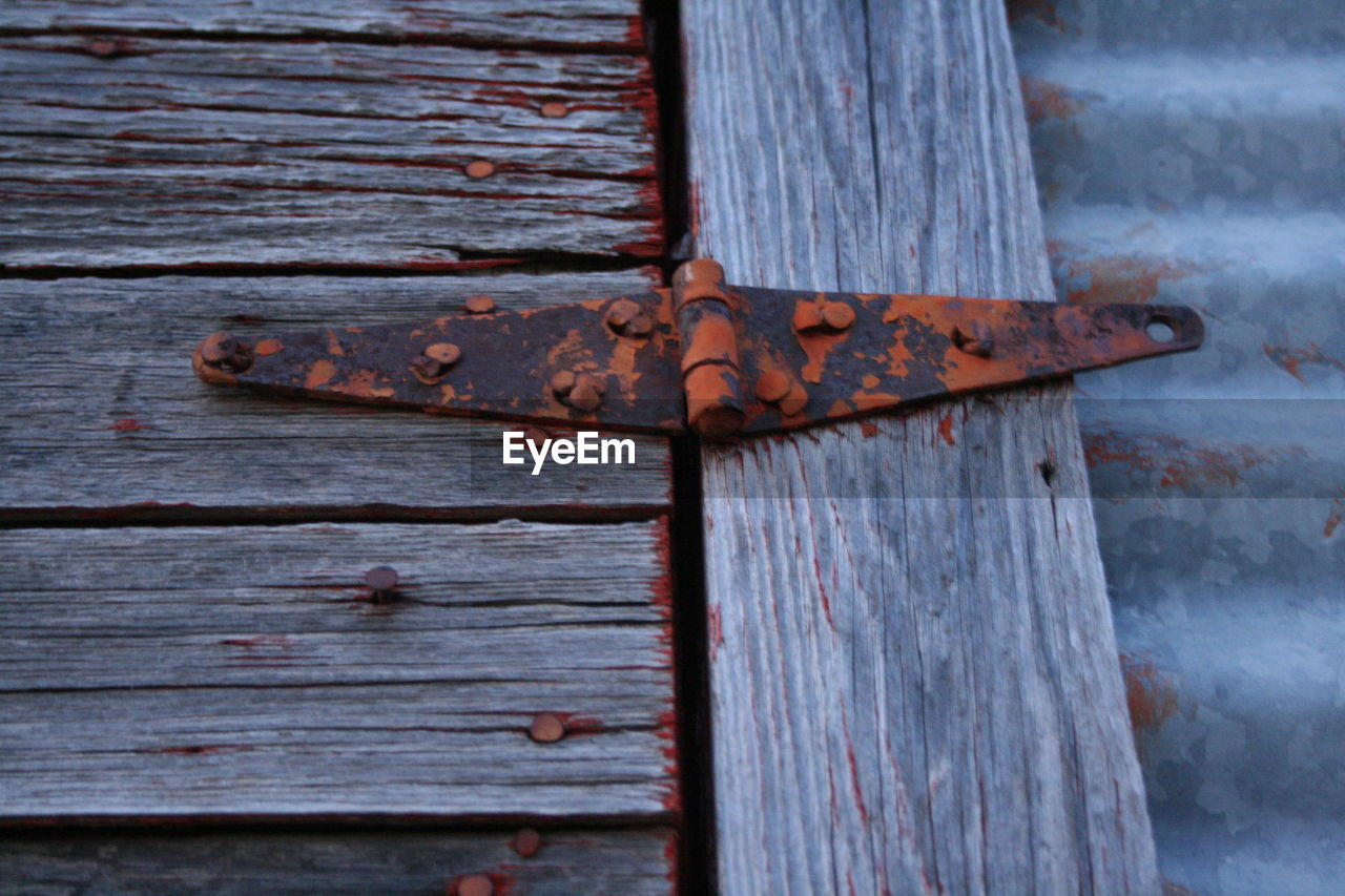 door, wood - material, weathered, latch, close-up, textured, metal, no people, rusty, outdoors, damaged, day, backgrounds, hinge