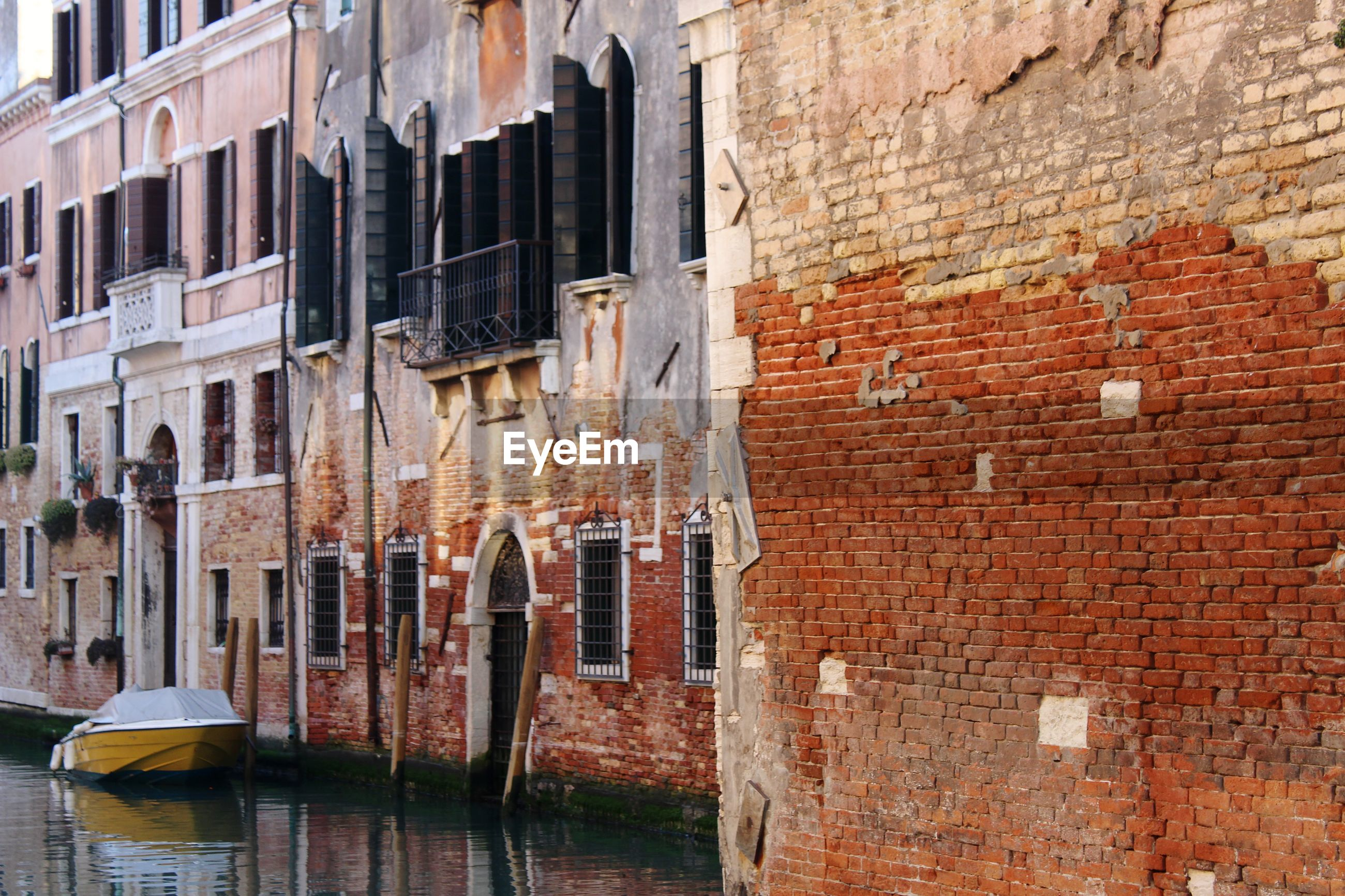 View of old building by canal in city