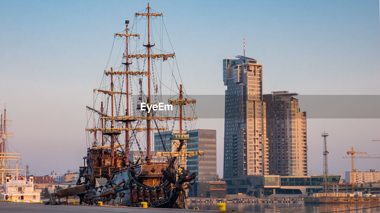 sky, nautical vessel, architecture, building exterior, built structure, transportation, industry, nature, ship, mode of transportation, machinery, water, no people, crane - construction machinery, development, sailboat, travel, clear sky, construction industry, day, outdoors, office building exterior, skyscraper
