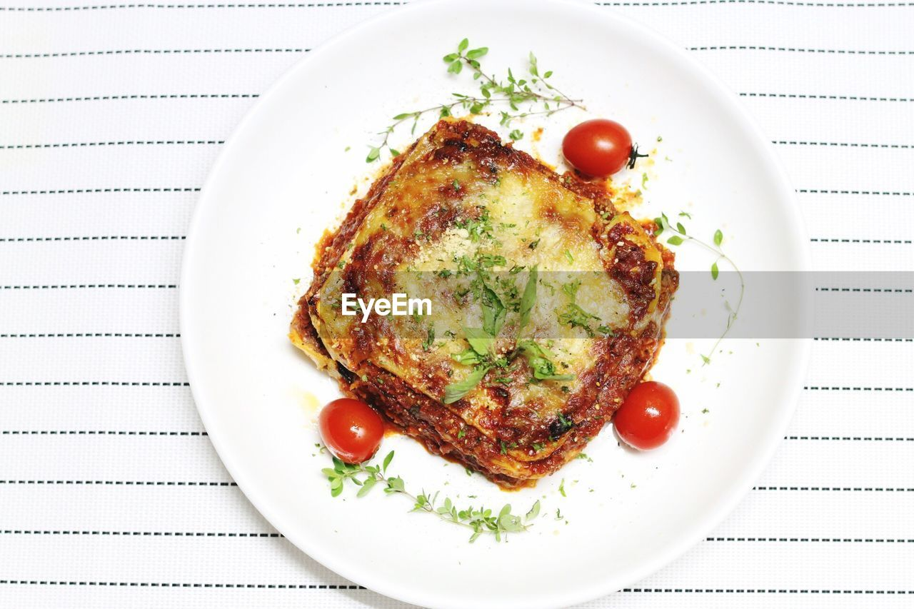 Directly Above Shot Of Lasagna Served On Table