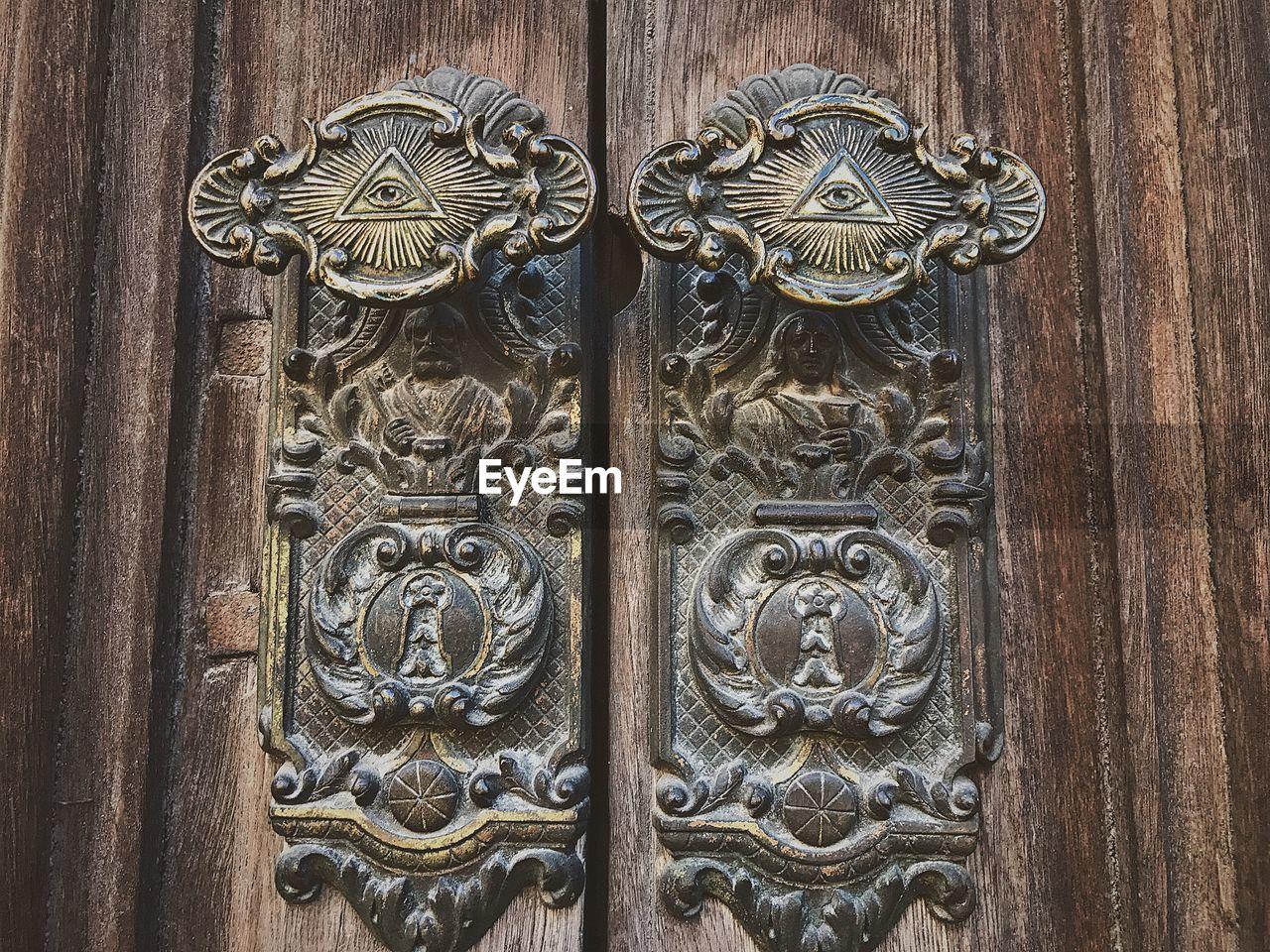 door, close-up, day, outdoors, wood - material, animal representation, door knocker, lion, lion - feline, no people, protection