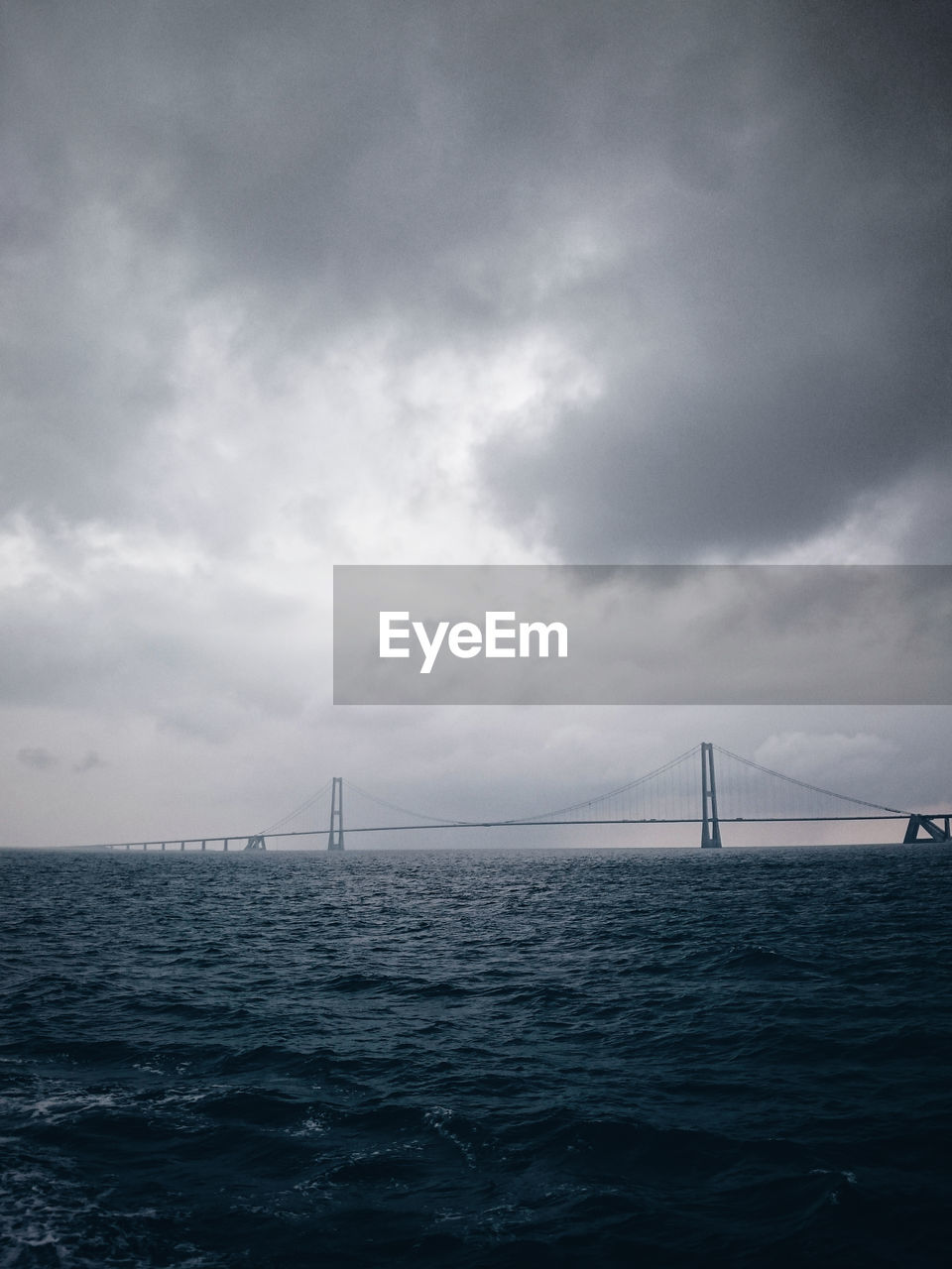 suspension bridge, sea, sky, bridge - man made structure, water, connection, cloud - sky, transportation, outdoors, no people, architecture, tranquil scene, travel destinations, day, tranquility, built structure, nature, scenics, beauty in nature, city