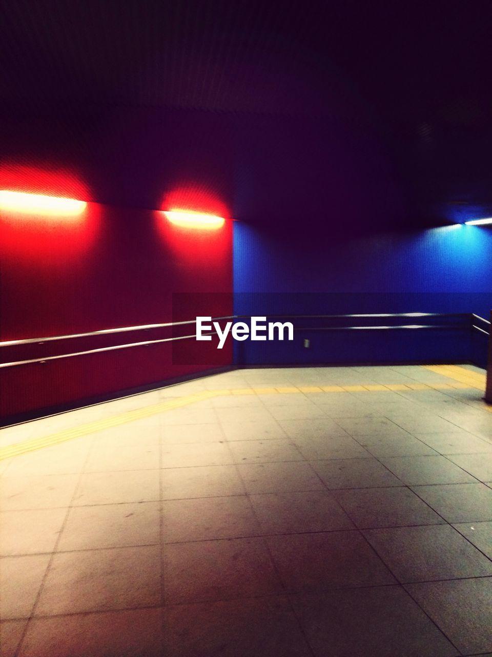 illuminated, indoors, tiled floor, lighting equipment, no people, night
