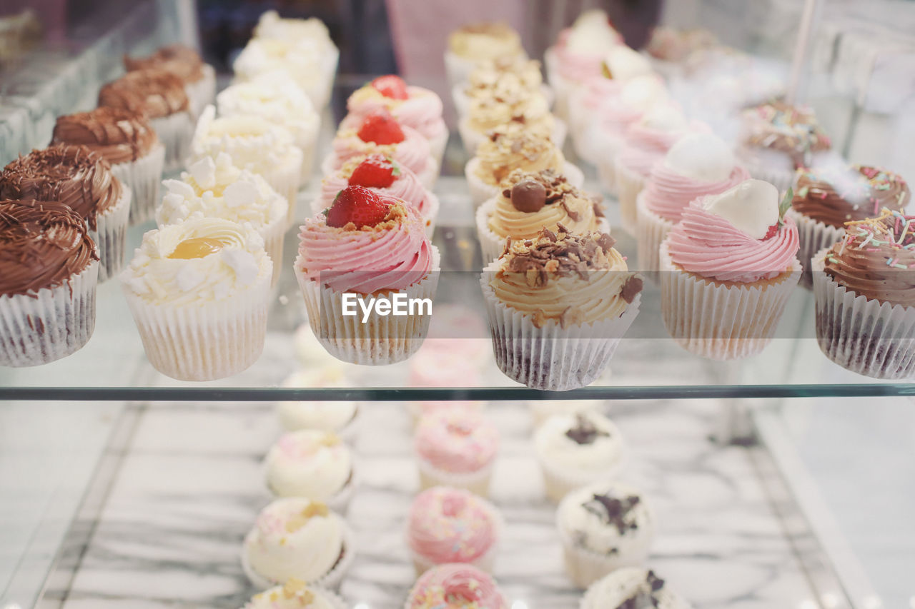 sweet food, sweet, dessert, indulgence, temptation, cake, unhealthy eating, food and drink, cupcake, freshness, food, choice, ready-to-eat, baked, variation, still life, indoors, store, no people, large group of objects, retail display, whipped cream, cupcake holder, order, icing
