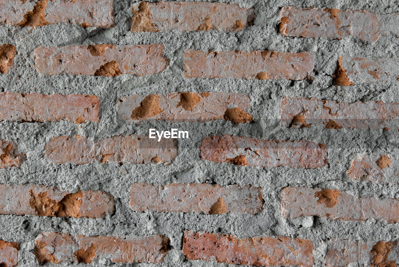 brick, brick wall, full frame, wall, backgrounds, wall - building feature, architecture, built structure, no people, textured, pattern, construction material, stone material, rough, outdoors, close-up, repetition, old, building exterior, day, cement, concrete