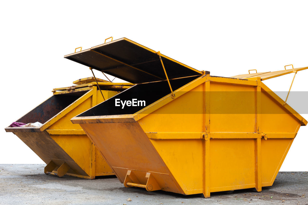 yellow, no people, day, clear sky, nature, outdoors, sky, container, garbage bin, transportation, recycling, nautical vessel, garbage, white background, metal, sunlight, plastic, wood - material, group of objects, water