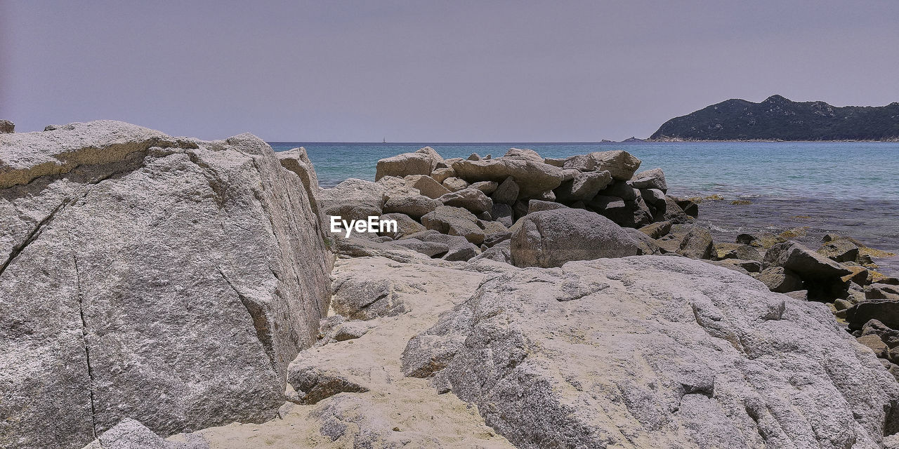 rock, sea, rock - object, sky, solid, water, beauty in nature, land, nature, scenics - nature, beach, rock formation, clear sky, horizon over water, tranquil scene, tranquility, day, copy space, horizon, no people, groyne, rocky coastline