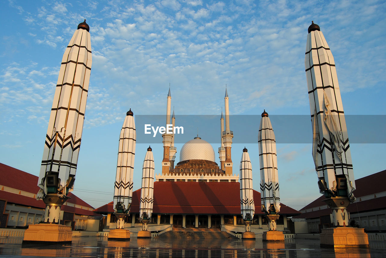 Low angle view of mosque against sky in city