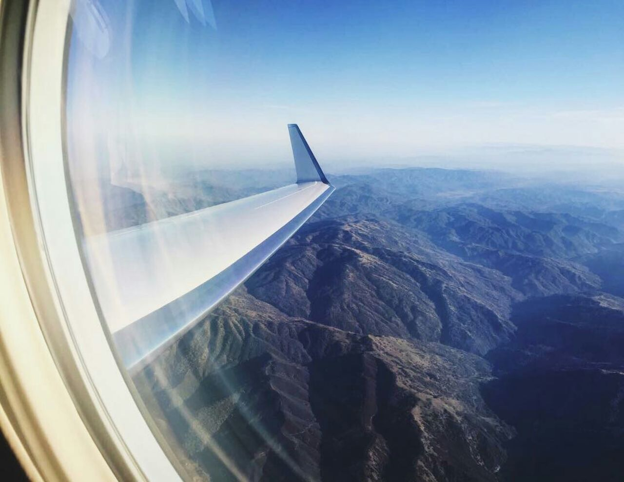 Aerial View Of Landscape Seen Through Airplane Window