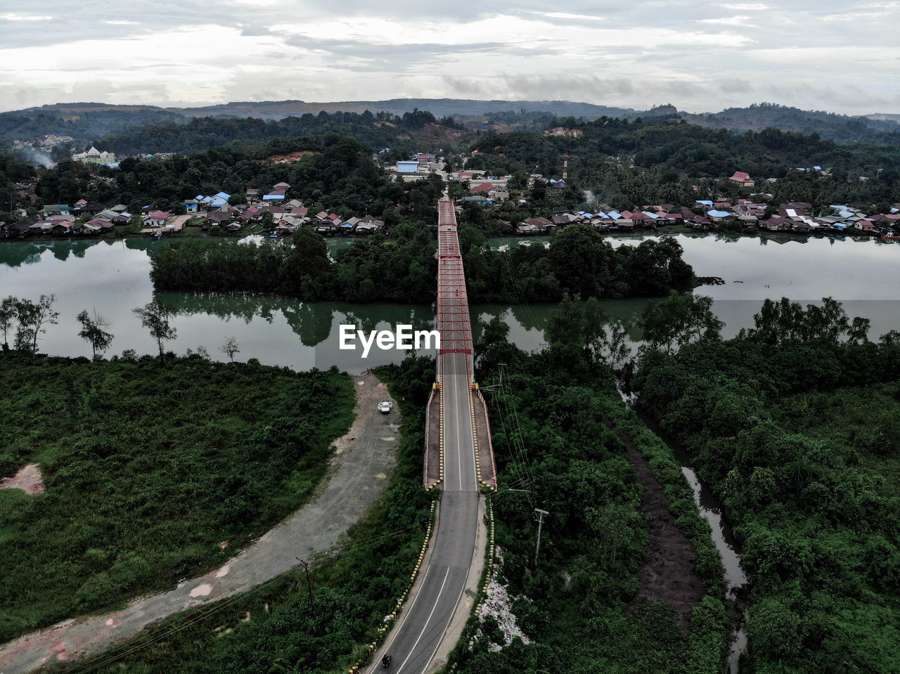 HIGH ANGLE VIEW OF ROAD BY TREES IN CITY