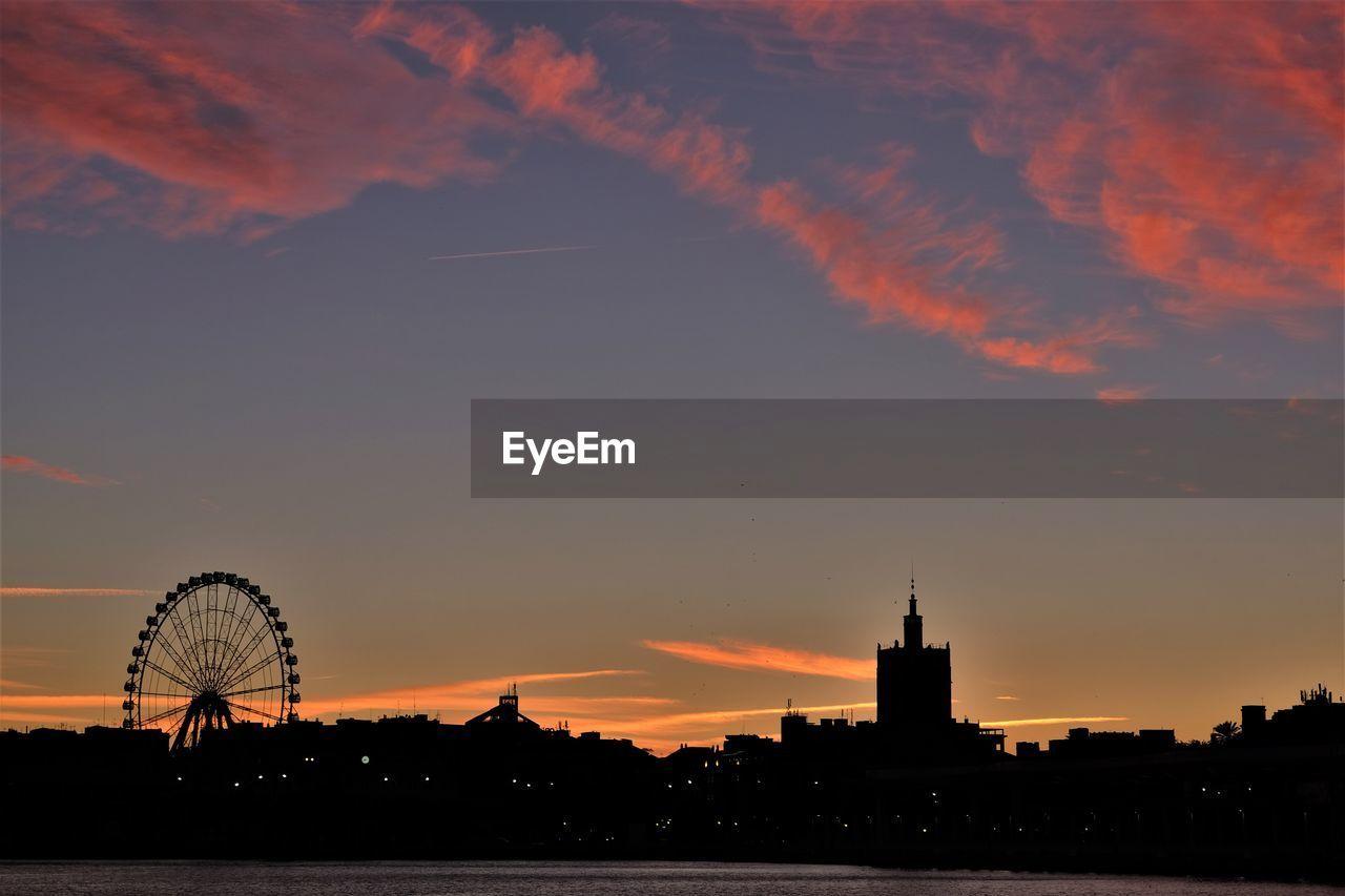 SILHOUETTE FERRIS WHEEL AGAINST SKY DURING SUNSET