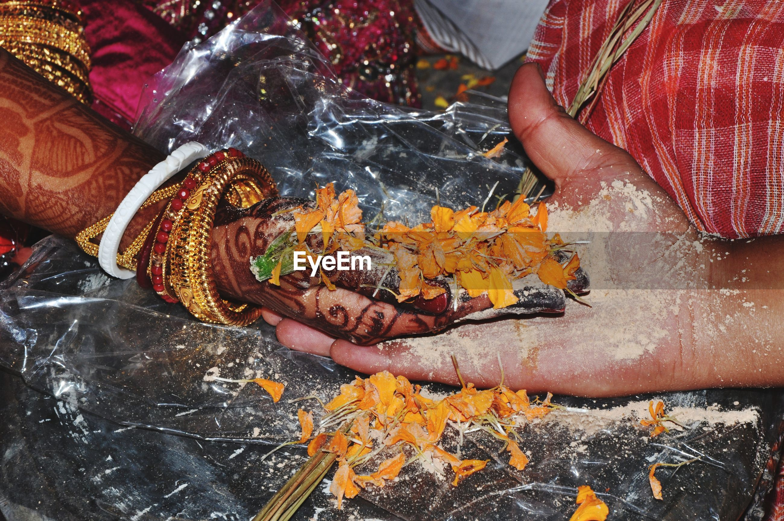 Cropped image of messy hands during wedding ceremony