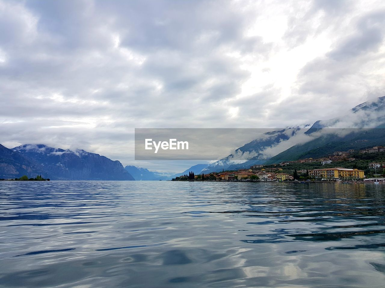 Scenic view of lake and snowcapped mountains against sky